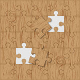 Puzzle made brown wood. Puzzle made of brown wood background Stock Photos