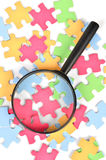Puzzle and magnifier Royalty Free Stock Photography