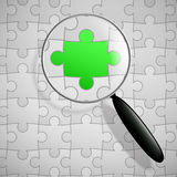 Puzzle and magnifier. Vector magnifying glass and puzzle background Royalty Free Stock Photography