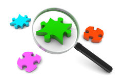 Puzzle and Magnifying Glass Royalty Free Stock Images