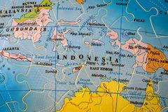 Puzzle map of Indonesia. Indonesia on the puzzle globe of the world royalty free stock images