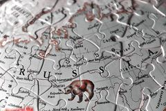 Puzzle Map and the Letters of the country name of Russia in black white red tint optic royalty free stock images