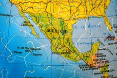 Puzzle map of Mexico. Mexico on the puzzle globe of the world royalty free stock photo