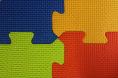 Puzzle mat, four colors Rubber Floor Abstract Background. Texture stock image