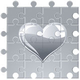 Puzzle metallic heart Stock Images