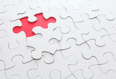 Puzzle with missing part Stock Images