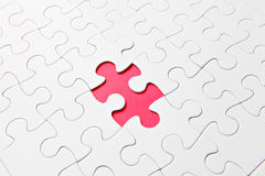 Puzzle with missing parts, which are connected Stock Photography