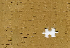 Puzzle with missing piece. Textured puzzle with missing piece Stock Photo