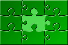 Puzzle with missing piece. A green puzzle with a missing piece Stock Photos