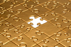 Puzzle with missing piece. Stock Image
