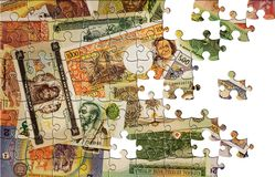 Puzzle with missing pieces. Money background Stock Photo