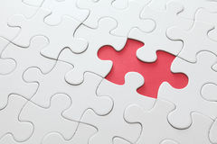 Puzzle with missing red piece Royalty Free Stock Photos