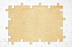 Puzzle. Missing puzzle among wooden board stock photo