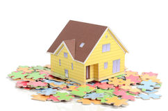 Puzzle and model house Royalty Free Stock Photography
