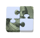 The Puzzle of Money. Shown by contrasting puzzle pieces interlocked with money portions  - path included Royalty Free Stock Images