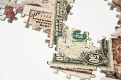 Puzzle of money Stock Photo