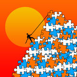 Puzzle mountain. Climbing puzzle mountain and trying to find a solution Stock Photos