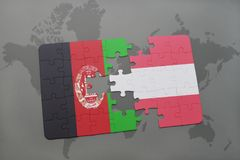 Puzzle with the national flag of afghanistan and austria on a world map background. 3D illustration Stock Images