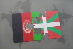 puzzle with the national flag of afghanistan and basque country on a world map background. Stock Photography