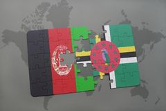 Puzzle with the national flag of afghanistan and dominica on a world map background. 3D illustration royalty free stock photos
