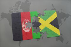 Puzzle with the national flag of afghanistan and jamaica on a world map background. 3D illustration royalty free stock images