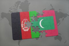 Puzzle with the national flag of afghanistan and maldives on a world map background. 3D illustration Royalty Free Stock Images