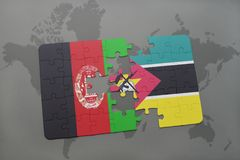 Puzzle with the national flag of afghanistan and mozambique on a world map background. 3D illustration Royalty Free Stock Photos