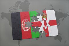 Puzzle with the national flag of afghanistan and northern ireland on a world map background. 3D illustration Royalty Free Stock Photography