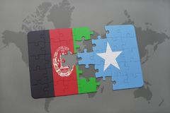 Puzzle with the national flag of afghanistan and somalia on a world map background. 3D illustration stock images