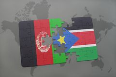 puzzle with the national flag of afghanistan and south sudan on a world map background. Stock Image