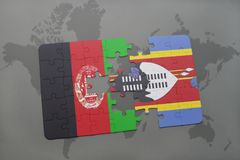 Puzzle with the national flag of afghanistan and swaziland on a world map background. Stock Photography