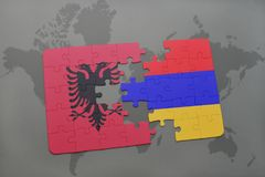 Puzzle with the national flag of albania and armenia on a world map background. Stock Photo