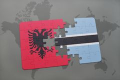 Puzzle with the national flag of albania and botswana on a world map. Background. 3D illustration stock photo