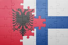 Puzzle with the national flag of albania and finland. Concept Royalty Free Stock Photography