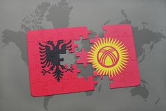 Puzzle with the national flag of albania and kyrgyzstan on a world map. Background. 3D illustration royalty free stock photography