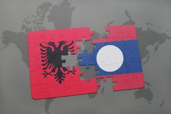 Puzzle with the national flag of albania and laos on a world map. Background. 3D illustration royalty free stock image