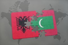 Puzzle with the national flag of albania and maldives on a world map. Background. 3D illustration royalty free stock image