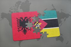 Puzzle with the national flag of albania and mozambique on a world map. Background. 3D illustration Royalty Free Stock Photo