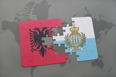 Puzzle with the national flag of albania and san marino on a world map background. Stock Image