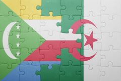 Puzzle with the national flag of algeria and comoros. Concept Royalty Free Stock Image