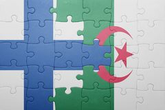 Puzzle with the national flag of algeria and finland. Concept Royalty Free Stock Photography