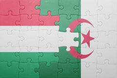 Puzzle with the national flag of algeria and hungary Royalty Free Stock Image