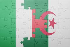 Puzzle with the national flag of algeria and italy Royalty Free Stock Photo