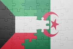Puzzle with the national flag of algeria and kuwait. Puzzle with the national flag of algeria and  kuwait. concept Royalty Free Stock Photo