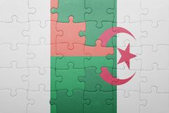Puzzle with the national flag of algeria and madagascar. Concept Royalty Free Stock Photo