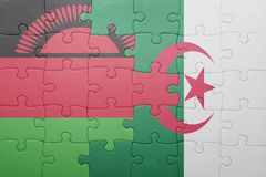 Puzzle with the national flag of algeria and malawi. Concept Royalty Free Stock Photos
