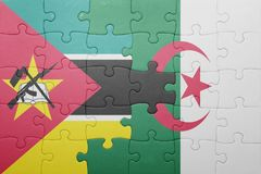 Puzzle with the national flag of algeria and mozambique Stock Photography