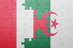 Puzzle with the national flag of algeria and peru Stock Image