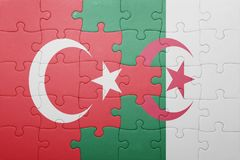 Puzzle with the national flag of algeria and turkey. Concept royalty free stock image