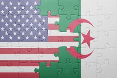 Puzzle with the national flag of algeria and united states of america. Concept Royalty Free Stock Image